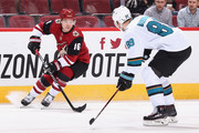 Max Domi #16 of the Arizona Coyotes skates with the puck ahead of Mikkel Boedker #89 of the San Jose Sharks during the third period of the NHL game at Gila River Arena on January 16, 2018 in Glendale, Arizona. The Sharks defeated the Coyotes 3-2 in an overtime shootout.