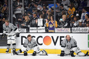 Fans show their appreciation in front of Matt Greene #2, Jarret Stoll #28 and Robyn Regehr #44 of the Los Angeles Kings before the game against the San Jose Sharks at Staples Center on April 11, 2015 in Los Angeles, California.