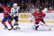 Carey Price #31 of the Montreal Canadiens makes a glove save on the puck in front of teammates Andrei Markov #79 and Melker Karlsson #68 of the San Jose Sharks during the NHL game at the Bell Centre on March 21, 2015 in Montreal, Quebec, Canada.