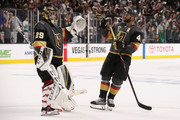 Goaltender Marc-Andre Fleury #29 of the Vegas Golden Knights is congratulated by Pierre-Edouard Bellemare #41 after defeating the San Jose Sharks in Game One of the Western Conference Second Round during the 2018 NHL Stanley Cup Playoffs at T-Mobile Arena on April 26, 2018 in Las Vegas, Nevada. The Golden Knights defeated the Sharks 7-0.