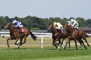 Ryan Moore riding Well Done Fox (L) win The Dragon Stakes at Sandown Park on July 6, 2018 in Esher, United Kingdom.