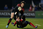 Jack Wilson of Saracens crunches into Kristian Phillips of Scarlets during the LV= Cup match between Saracens and Scarlets at Allianz Park on November 17, 2013 in Barnet, England.