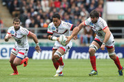 Chris Masoe of Toulon breaks with the ball with Sebastien Tillous-Borde (L) and Juan Martin Fernandez Lobbe in support during the Heineken Cup semi final match between Saracens and Toulon at Twickenham Stadium on April 28, 2013 in London, United Kingdom.