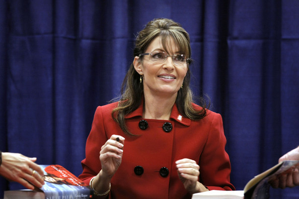 Former Republican vice presidential candidate and Alaska Governor Sarah Palin signs her new book, Going Rogue for a customer at a Barnes & Noble bookstore November 18, 2009 in Grand Rapids, Michigan. Palin chose Grand Rapids as the first stop of her book signing tour.