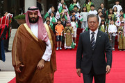 South Korean President Moon Jae-In (R) and Saudi Crown Prince Mohammed bin Salman (L) walk towards a guard of honour during a welcoming ceremony at the presidential Blue House on June 26, 2019 in Seoul, South Korea. Prince Mohammed Bin Salman is visiting South Korea for two days - the first time by an heir to the throne of Saudi Arabia since 1998.