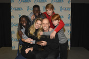 """(L-R) Eveline, Tracie, Jen Paul, Scott, Adien and Max Hamilton take photos before the second annual """"An Evening Of Scott Hamilton & Friends"""" hosted by Scott Hamilton to benefit The Scott Hamilton CARES Foundation on November 19, 2017 in Nashville, Tennessee."""