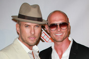 """Recording artist Matt Goss (L) and twin brother actor Luke Goss attend a screening of Films In Motion & Lionsgate Entertainment's """"Blood Out"""" at the DGA on April 25, 2011 in Los Angeles, California."""