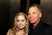 """Actress Allie Grant (L) and producer David Permut pose at the after party for a screening of Tribeca Film's """"Struck By Lightning"""" at Eden on January 6, 2013 in Los Angeles, California."""