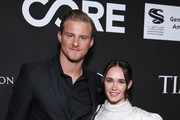 Alexander Ludwig (L) and Kristy Dinsmore attend the 10th Anniversary Gala Benefiting CORE hosted by Sean Penn, Bryan Lourd And Vivi Nevo at Wiltern Theatre on January 15, 2020 in Los Angeles, California.