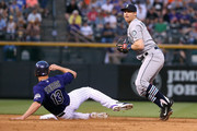 Shortstop Brad Miller #5 of the Seattle Mariners gets a force out on Drew Stubbs #13 of the Colorado Rockies during interleague play at Coors Field on August 3, 2015 in Denver, Colorado. The Mariners defeated the Rockies 8-7.