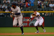Trevor Story #27 of the Colorado Rockies fields a ground ball as Denard Span #4 of the Seattle Mariners runs the bases in the first inning of a game at Coors Field on July 15, 2018 in Denver, Colorado.