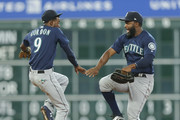 Dee Gordon #9 of the Seattle Mariners celebrates  with Denard Span #4 after defeating the Houston Astros 4-3 in 10 innings to  sweep the series at Minute Maid Park on August 12, 2018 in Houston, Texas.