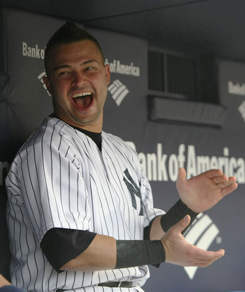 Nick Swisher Nick Swisher #33 of the New York Yankees sits in the dugout before a game against the Seattle Mariners at Yankee Stadium on July 2, 2009 in the Bronx borough of New York City.
