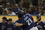 Nelson Cruz #23 of the Seattle Mariners is being congratulated by teammate Kyle Seager #15 after scoring on a solo home run during the fourth inning against the Oakland Athletics at Oakland Alameda Coliseum on August 31, 2018 in Oakland, California.