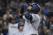 Nelson Cruz #23 of the Seattle Mariners looks skyward after hitting a solo home run during the ninth inning of a baseball game against the San Diego Padres at PETCO Park on August 28, 2018 in San Diego, California.