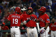 (L-R)  Jurickson Profar #19 celebrates a three-run homerun with Elvis Andrus #1 and Adrian Beltre #29 of the Texas Rangers in the fifth inning against the Seattle Mariners at Globe Life Park in Arlington on August 7, 2018 in Arlington, Texas.