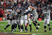 Kicker Sebastian Janikowski #11 of the Seattle Seahawks celebrates with teammates offensive guard J.R. Sweezy #64 and punter Michael Dickson #4 after kicking the game winning field goal as time expired in the fourth quarter against the Arizona Cardinals at State Farm Stadium on September 30, 2018 in Glendale, Arizona. The Seahawks beat the Cardinals 20-17.