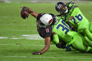 Wide receiver Larry Fitzgerald #11 of the Arizona Cardinals completes a pass against defensive back Bradley McDougald #30 and cornerback Shaquill Griffin #26 of the Seattle Seahawks in the second half at University of Phoenix Stadium on November 9, 2017 in Glendale, Arizona.