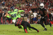 Tight end Jimmy Graham #88 of the Seattle Seahawks is tackled by defensive back Tramon Williams #25 of the Arizona Cardinals after a reception during the first half of the NFL game at the University of Phoenix Stadium on November 9, 2017 in Glendale, Arizona.