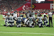 Members of the Seattle Seahawks kneel while trainers tend to defensive back Earl Thomas #29 (not pictured) during the fourth quarter against the Arizona Cardinals at State Farm Stadium on September 30, 2018 in Glendale, Arizona.