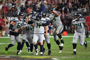 Kicker Sebastian Janikowski #11 of the Seattle Seahawks celebrates with teammates offensive guard J.R. Sweezy #64 and center Justin Britt #68 after kicking the game winning field goal as time expired in the fourth quarter against the Arizona Cardinals at State Farm Stadium on September 30, 2018 in Glendale, Arizona. The Seahawks beat the Cardinals 20-17.