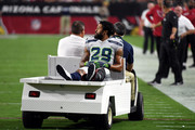 Defensive back Earl Thomas #29 of the Seattle Seahawks leaves the field on a cart after being injured during the fourth quarter against the Arizona Cardinals at State Farm Stadium on September 30, 2018 in Glendale, Arizona.