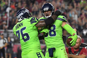 Tight end Jimmy Graham #88 of the Seattle Seahawks celebrates a six yard touchdown with offensive tackle Duane Brown #76 against the Arizona Cardinals in the first half at University of Phoenix Stadium on November 9, 2017 in Glendale, Arizona.