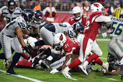 Running back David Johnson #31 of the Arizona Cardinals dives for a second-quarter touchdown during the game against the Seattle Seahawks at State Farm Stadium on September 30, 2018 in Glendale, Arizona.
