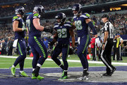 Ethan Pocic #77 of the Seattle Seahawks and Jimmy Graham #88 of the Seattle Seahawks celebrate the touchdown by Doug Baldwin #89 of the Seattle Seahawks in the fourth quarter of a football game against the Dallas Cowboys at AT&T Stadium on December 24, 2017 in Arlington, Texas.