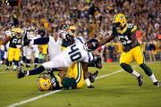 Derrick Coleman #40 of the Seattle Seahawks gets tackled after catching a pass against Morgan Burnett #42 of the Green Bay Packers during their game at Lambeau Field on September 20, 2015 in Green Bay, Wisconsin.