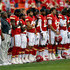Head coach Romeo Crennel of the Kansas City Chiefs stands with players during the National Anthem prior to the NFL preseason game against the Seattle Seahawks at Arrowhead Stadium on August 24, 2012 in Kansas City, Missouri.