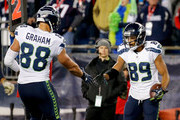 Doug Baldwin #89 of the Seattle Seahawks celebrates with Jimmy Graham #88 after catching a touchdown pass during the second quarter of a game against the New England Patriots at Gillette Stadium on November 13, 2016 in Foxboro, Massachusetts.
