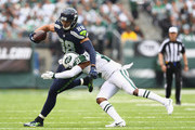 Marcus Gilchrist #21 of the New York Jets attempts to tackle Jimmy Graham #88 of the Seattle Seahawks in the third quarter at MetLife Stadium on October 2, 2016 in East Rutherford, New Jersey.