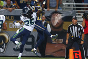 Tavon Austin #11 of the St. Louis Rams can't come down with the catch as Richard Sherman #25 of the Seattle Seahawks breaks up a pass in the first half at the Edward Jones Dome on September 13, 2015 in St. Louis, Missouri.