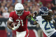 Running back David Johnson #31 of the Arizona Cardinals runs with the ball as Shaquill Griffin #26 of the Seattle Seahawks defends during an NFL game at State Farm Stadium on September 30, 2018 in Glendale, Arizona.