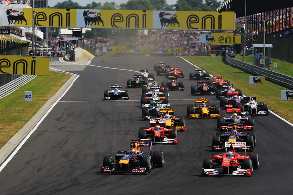 Sebastian Vettel Sebastian Vettel (L) of Germany and Red Bull Racing leads Fernando Alonso (R) of Spain and Ferrari into the first corner at the start of the the Hungarian Formula One Grand Prix at the Hungaroring on August 1, 2010 in Budapest, Hungary.