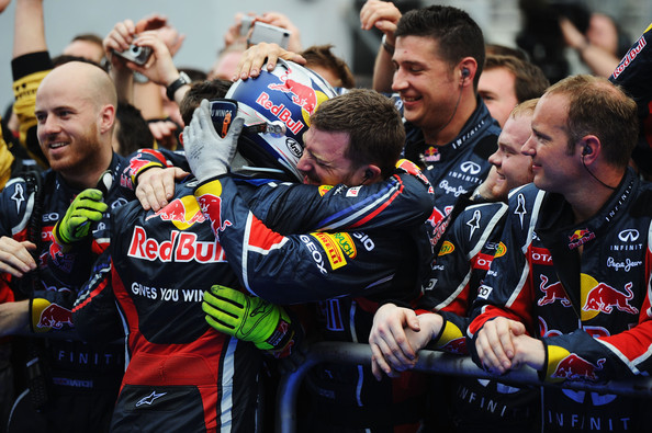 Sebastian Vettel Sebastian Vettel of Germany and Red Bull Racing celebrates with team mates in parc ferme after winning the Malaysian Formula One Grand Prix at the Sepang Circuit on April 10, 2011 in Kuala Lumpur, Malaysia.