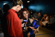 """TV personality Nicole """"Snooki"""" LaValle and son Lorenzo are interviewed at Moynihan Station during Spring 2016 New York Fashion Week: The Shows - Day 1 on September 10, 2015 in New York City."""