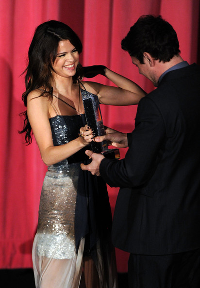 Selena Gomez Actor Cory Monteith accepts the Male Future Style Icon Award from presenter Selena Gomez onstage at the 2010 Hollywood Style Awards at the Hammer Museum on December 12, 2010 in Westwood, California.
