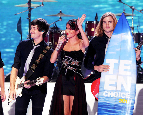 Selena Gomez Singer Selena Gomez with Selena Gomez & The Scene accept the Choice Music group award onstage during the 2011 Teen Choice Awards held at the Gibson Amphitheatre on August 7, 2011 in Universal City, California.
