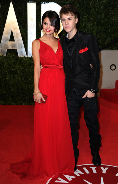 Selena Gomez Singer/actress Selena Gomez and singerJustin Bieber arrive at the Vanity Fair Oscar party hosted by Graydon Carter held at Sunset Tower on February 27, 2011 in West Hollywood, California.