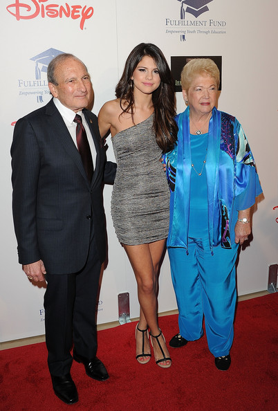 "Selena Gomez Singer/actress Selena Gomez (C) with .Fulfillment Fund Co-Founders Dr. Gary Gitnic (L) and Cherna Gitnic (R) arrive at The Fulfillment Fund's ""2011 Stars Gala"" held at The Beverly Hilton Hotel on November 1, 2011 in Beverly Hills, California."