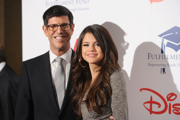 "Selena Gomez Honoree and Chairman, The Walt Disney Studios Rich Ross and singer/actress Selena Gomez arrive at The Fulfillment Fund's ""2011 Stars Gala"" held at The Beverly Hilton Hotel on November 1, 2011 in Beverly Hills, California."