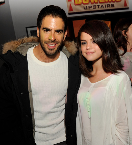 "Selena Gomez Actors Eli Roth (L) and Selena Gomez pose at the after party of Universal Pictures' ""The Thing' at Jillians on October 10, 2011 in Universal City, California."