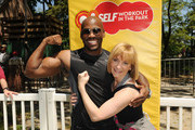 Dolvett Quince and Laura McEwen attend Self Magazine's 19th Annual Workout In The Park on May 12, 2012 in New York City.