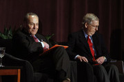 U.S. Senate Majority Leader Mitch McConnell (right) (R-KY) and U.S. Senate Democratic Leader Chuck Schumer (D-NY) wait on stage together at the University of Louisville's McConnell Center where Schumer was scheduled to speak February 12, 2018 in Louisville, Kentucky. Sen. Schumer spoke at the event as part of the Center's Distinguished Speaker Series, and Sen. McConnell introduced him.