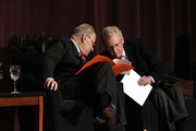 U.S. Senate Majority Leader Mitch McConnell (right) (R-KY) and U.S. Senate Democratic Leader Chuck Schumer (D-NY) wait the stage together at the University of Louisville's McConnell Center where Schumer was scheduled to speak February 12, 2018 in Louisville, Kentucky. Sen. Schumer spoke at the event as part of the Center's Distinguished Speaker Series, and Sen. McConnell introduced him.