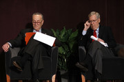 U.S. Senate Majority Leader Mitch McConnell (right) (R-KY) and U.S. Senate Democratic Leader Chuck Schumer (D-NY) wait on the stage together at the University of Louisville's McConnell Center where Schumer was scheduled to speak February 12, 2018 in Louisville, Kentucky. Sen. Schumer spoke at the event as part of the Center's Distinguished Speaker Series, and Sen. McConnell introduced him.