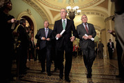 (L-R) U.S. Sen. Lindsey Graham (R-SC), Senate Minority Leader Mitch McConnell (R-KY) and U.S. Sen. Jon Kyl (R-AZ) approach the microphones to talk to the press after the weekly Senate Republican policy luncheon at the U.S. Captiol November 29, 2011 in Washington, DC. The Senate Democratic and Republican caucuses met separately behind closed doors to discuss the annual $226 billion Defense Authorization legislation. The White House has threatened to veto the military spending bill over parts of the bill requiring that al-Qaeda members captured on US soil be held by the military and not civilian authorties. Senate Armed Services Committee ranking member U.S. Sen. John McCain (R-AZ) said there was a robust debate on the detainee issue during the GOP luncheon, but Cheney did not join the discussion.