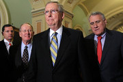 U.S. Senate Minority Leader Sen. Mitch McConnell (R-KY) (2nd R), Sen. Lamar Alexander (R-TN) (2nd L), Senate Minority Whip Sen. Jon Kyl (R-AZ) (R), and Sen. John Barrasso (R-WY) (L) approach the podium for a news briefing after the Republican weekly policy luncheon July 26, 2011 on Capitol Hill in Washington, DC. The Senate Republicans discussed the latest development of the debt ceiling negotiation.
